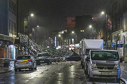 © Licensed to London News Pictures. 14/01/2020. Slough, UK. A huge section of metal roof sits on the High Street in Slough after winds from storm Brendon tore it from the top of a building. Photo credit: Peter Manning/LNP