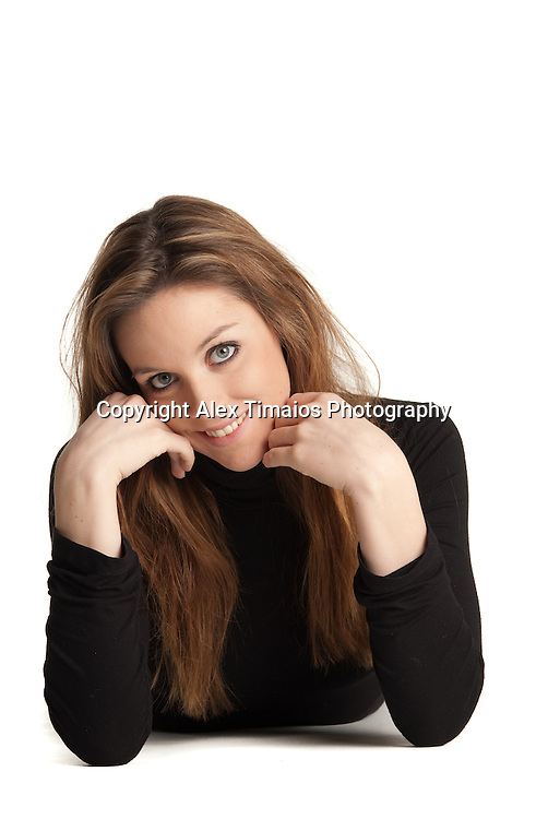 Young girl lying down isolated in white background