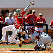 Arkansas catcher Jake Wise tags Mississippi's Brantley Bell (28) out at home during an NCAA college baseball game in Oxford, Miss., Saturday, May 3, 2014. (Photo/Thomas Graning)