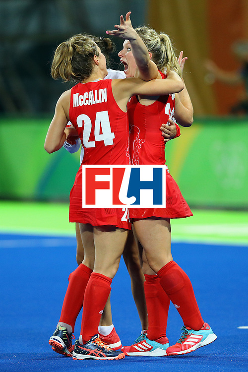 RIO DE JANEIRO, BRAZIL - AUGUST 19:  Hollie Webb #20 of Great Britain (R) celebrates with teammates after scoring the game-winning penalty goal against the Netherlands during the Women's Gold Medal Match on Day 14 of the Rio 2016 Olympic Games at the Olympic Hockey Centre on August 19, 2016 in Rio de Janeiro, Brazil.  (Photo by Tom Pennington/Getty Images)