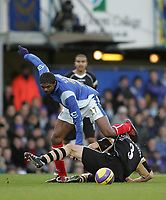 Photo: Lee Earle.<br /> Portsmouth v Charlton Athletic. The Barclays Premiership. 20/01/2007.Pompey's Kanu (L) clashes with Hermann Hreidarsson.