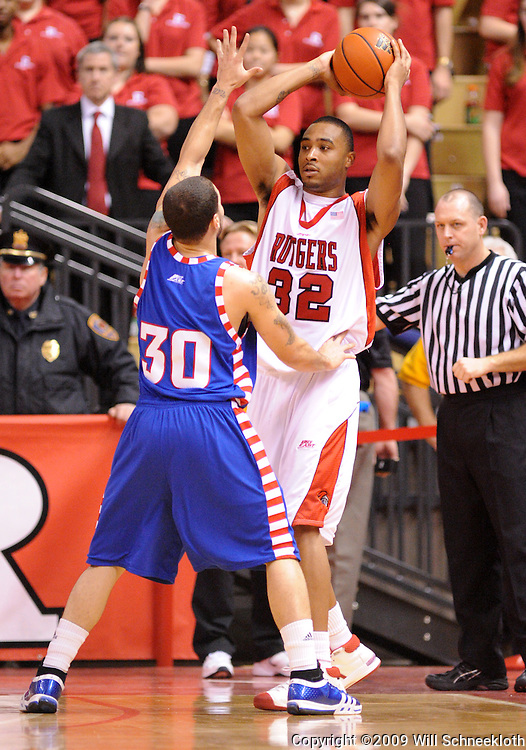 Jan 31, 2009; Piscataway, NJ, USA; Rutgers guard/forward Jaron Griffin (32) controls the ball away from DePaul guard Will Walker (30) during the second half of Rutgers' 75-56 victory over DePaul in NCAA college basketball at the Louis Brown Athletic Center