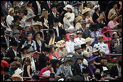 Racegoers gather around the parade ring at Royal Ascot 2013 Ascot, United Kingdom, to see the HM The queen arrive,<br /> Thursday, 20th June 2013<br /> Picture by Andrew Parsons / i-Images
