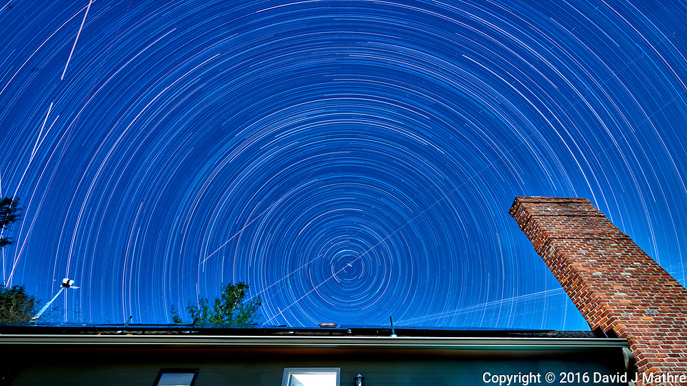 Startrails looking north. The north star isn't exactly due north. Composite of 65 images taken with a Nikon D810a camera and 14-24 mm f/2.8 lens (ISO 200, 14 mm, f/8, 300 sec).