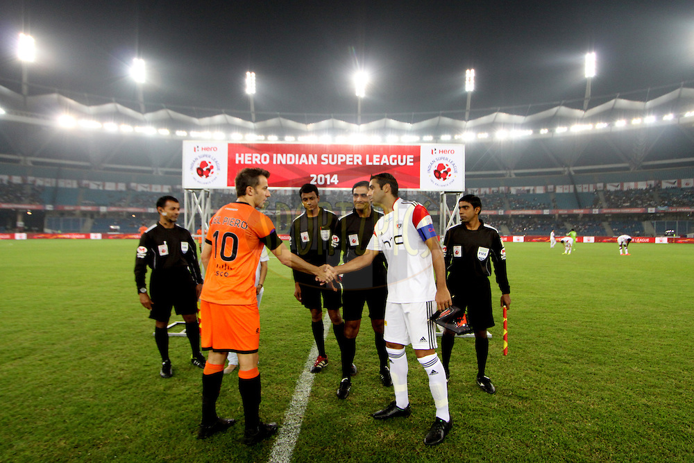 Delhi Dynamos alessandro del Piero shake hand with NorthEast United FC captain Miguel Garcia during match 16 of the Hero Indian Super League between The Delhi Dynamos FC and NorthEast United FC held at the Jawaharlal Nehru Stadium, Delhi, India on the 29th October 2014.<br /> <br /> Photo by:  Arjun Panwar/ ISL/ SPORTZPICS