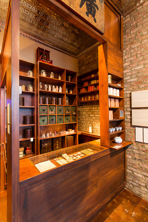 A reproduction of a d=general store includes bins for herbs, teas, and a tea set.