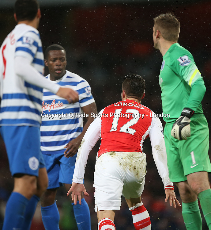 26 December 2014 Premier League Football - Arsenal v Queens Park Rangers ;  Olivier Giroud of Arsenal takes exception to a challenge from Nedum Onuoha of Rangers.<br /> Photo: Mark Leech.