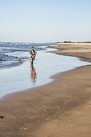 Father riding a bicycle with his son in Jaguaruna Beach. Jaguaruna, Santa Catarina, Brazil. / <br /> Pai andando de bicicleta com seu filho na Praia de Jaguaruna (Balneário Arroio Corrente). Jaguaruna, Santa Catarina, Brasil.