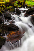 Secret waterfall spills over boulders on Kodiak Island