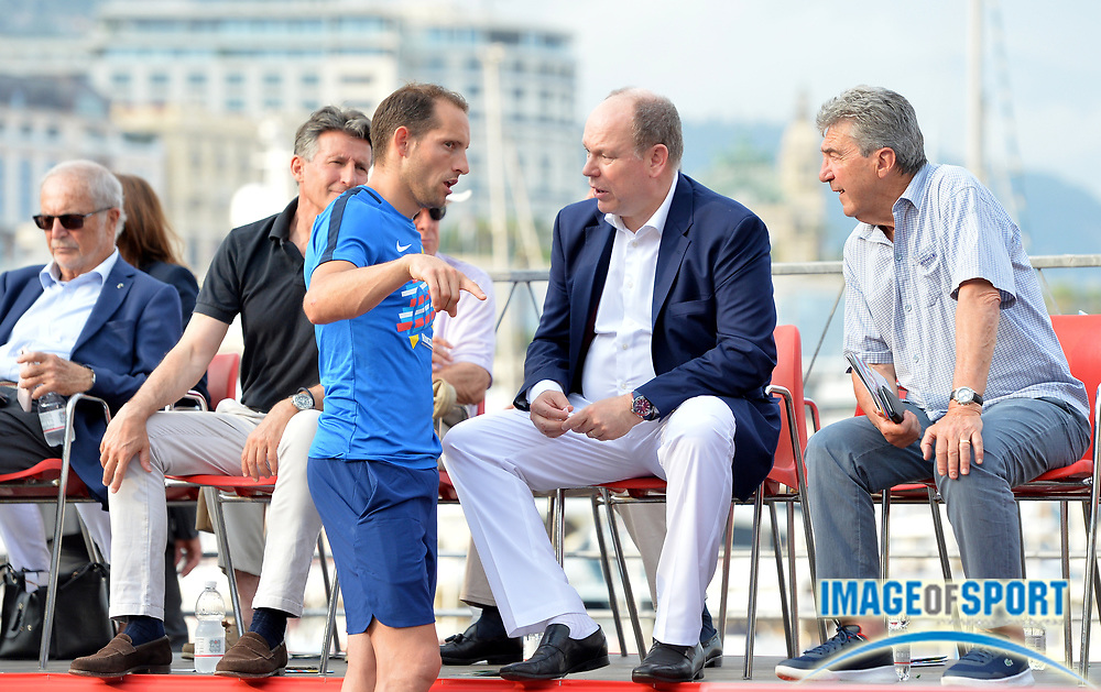 Pole vaulter Renaud Lavillenie (FRA), center, talks with IAAF president Sebastian Coe  (left) and Prince Albert II aka Albert Alexandre Louis Pierre Grimald watch during the women's triple jump in the  Herculis Monaco in an IAAF Diamond League meet , Thursday, July 11, 2019, in Port Hercules, Monaco.(Jiro Mochizuki/Image of Sport)