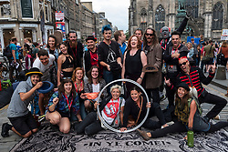 Edinburgh, Scotland, UK; 3 August, 2018. Official Opening of the new Virgin Money Fringe Street Events on the Royal Mile in Edinburgh. Performers and Shona McCarthy Chief Executive of the Edinburgh Fringe Society gather to cut the red ribbon and open this year's Fringe Festival.