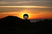 Crystal ball on a rock on a Jekyll Island beach at sunrise, sunset