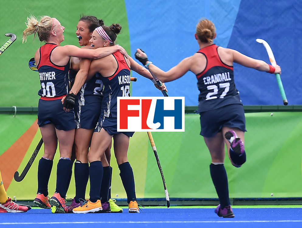 The USA's Caitlin van Sickle (2L) celebrates scoring a goal during the women's field hockey Australia vs USA match of the Rio 2016 Olympics Games at the Olympic Hockey Centre in Rio de Janeiro on August, 8 2016. / AFP / MANAN VATSYAYANA        (Photo credit should read MANAN VATSYAYANA/AFP/Getty Images)