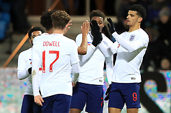 England U21's Dominic Solanke (right) celebrates scoring his side's second goal of the game with team-mates during the international friendly match at the Blue Water Arena, Esbjerg.