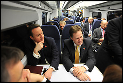 Britain's Prime Minister David Cameron (L) and Deputy Prime Minister Nick Clegg ride a train to a cabinet meeting at the 2012 Olympic Games site in London, As the London Olympics countdown enters its final 200 days Cameron highlighted the 'lasting legacy' the London 2012 Olympics will leave, with further venues securing long-term running contracts, Monday January 9, 2012. Photo By Andrew Parsons/ i-Images