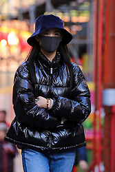 © Licensed to London News Pictures. 29/01/2020. London, UK. A woman is seen in London's Chinatown wearing a fashionable face mask following the outbreak of Coronavirus in Coronavirus in Wuhan, China which has killed 132 people and infected more than 6,000. According to the Department of Heath, 97 people have been tested for Coronavirus in the UK and all have been confirmed negative. Photo credit: Dinendra Haria/LNP