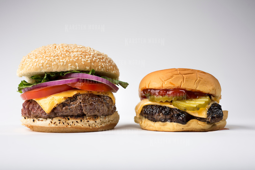 "June 11, 2014 - New York, NY : New York Times writer and editor Sam Sifton describes the difference between ""pub"" and ""diner""-style hamburgers. The ""pub"" burger, which is pictured here at left, is larger, shaped like a fat hockey puck, and takes longer to cook. By contrast the ""diner"" burger, at right, is smaller, shaped like a frisbee, and cooks substantially quicker. CREDIT: Karsten Moran for The New York Times"