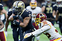 NEW ORLEANS, LA - NOVEMBER 19:  Mark Ingram II #22 of the New Orleans Saints runs the ball and is tackled by D.J. Swearinger #36 of the Washington Redskins at Mercedes-Benz Superdome on November 19, 2017 in New Orleans, Louisiana.  Saints defeated the Redskins 34-31.  (Photo by Wesley Hitt/Getty Images) *** Local Caption *** Mark Ingram II;  D.J. Swearinger