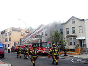 Alarm fire breaks out at 410 West Side Ave in Jersey City. With at least one person taken away by ambulance but some reports say as many as three people were taken to hospitals. The fire started sometime around 6:00PM and was controlled by around 7:10PM. Photo By Mark Apollo/Hashtag Occupy Media