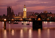 Big Ben, the Houses of Parliament  and Hungerford railway bridge crossing the River Thames in London, UK