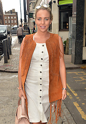 TOWIE star Lydia Bright wearing a white button dress, suede tassel jacket and matching boots, out and about in Notting Hill in London, UK. 27/08/2015<br />