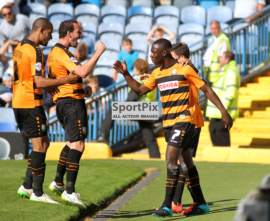 Andy Yiadom celebrates with his Barnet team mates During Portsmouth vs Barnet on Saturday 12th September 2015.