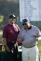 12 December 2004: Tiger Woods closed out the final round of golf with 5-under-par 66 for a two-shot victory over Padraig Harrington (Ireland) at the 2004 Target World Challenge Presented by Williams held at the Sherwood Country Club in Thousand Oaks, CA.  Tiger here with his father Earl Woods on the 18th hole joking around after winning the tournament..