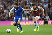 Everton midfielder Andre Gomes (21) sprints forward with the ball  chased by Aston Villa midfielder John McGinn (7) during the Premier League match between Aston Villa and Everton at Villa Park, Birmingham, England on 23 August 2019.