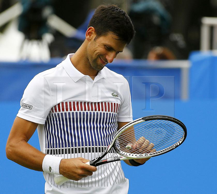 &copy; London News Pictures. 28/06/2017. Novak Djokovic v Vasek Pospisil at Aegon International Tennis Eastbourne<br /> Djokovic won the match 6.4 6.3. Photo credit: Sean Aiden/LNP