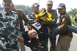 March 10, 2017 - Delhi, India - Tibetan Youth Congress activist being detained by police at a protest outside the Chinese Embassy on the commemoration of the 58th anniversary of Tibetan National Uprising Day, against the Chinese rule on Friday. (Credit Image: © Shrikant Singh/Pacific Press via ZUMA Wire)
