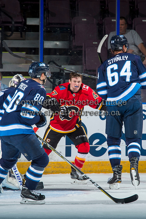 PENTICTON, CANADA - SEPTEMBER 11: Matthew Phillips #47 of the Calgary Flames loses his helmet against the Winnipeg Jets on September 11, 2017 at the South Okanagan Event Centre in Penticton, British Columbia, Canada.  (Photo by Marissa Baecker/Shoot the Breeze)  *** Local Caption ***