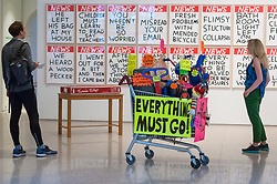 "© Licensed to London News Pictures. 05/06/2018. LONDON, UK. ""Closing Down Sale"" by Michael Landy RA in front of a set of screen prints ""Untitled"" by David Shrigley at a preview of the 250th Summer Exhibition at the Royal Academy of Arts in Piccadilly, which has been co-ordinated by Grayson Perry RA this year.  Running concurrently, is The Great Spectacle, featuring highlights from the past 250 years.  Both shows run 12 June to 19 August 2018.  Photo credit: Stephen Chung/LNP"