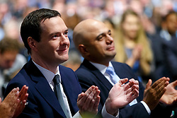 © Licensed to London News Pictures. 07/10/2015. Manchester, UK. GEORGE OSBORNE and SAJID JAVID listening Prime Minister David Cameron speaking at Conservative Party Conference at Manchester Central convention centre on Wednesday, 7 October 2015. Photo credit: Tolga Akmen/LNP