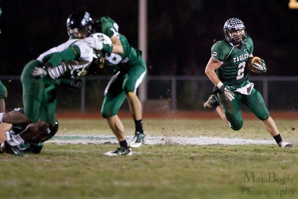 West Deptford High School's Josh Cornelius (2) runs the ball during a Group 2 first round playoff game at West Deptford High School on Friday November 11, 2011. (photo / Mat Boyle)