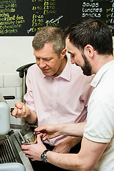 Pictured: Willie Rennie was shown  how to make great coffee by cafe worker Graham Burnett.<br /> <br /> Scottish Liberal Democrat leader Willie Rennie met staff and customers at the Grassmarket café, part of the Grassmarket Community Project, as he visited the Edinburgh social enterprise today as part of his election campaign. He took the opportunity to set out Lib Dem student support plans ahead of an NUS election hustings in Glasgow. <br /> Ger Harley | EEm 11 April 2016