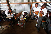 Learners fromGrade 4 working with out desks...Mkanzini Junior Secondary School is one of 395 'mud schools' in the Eastern Cape where buildings are dilapidated and unsafe with insufficient desks and chairs. Facilities are lacking and there is no money for maintenance. Students learn under terrible conditions. Corrugated roofs leak when it rains, when its hot the heat becomes unbearable and when its cold it is too cold to write...Mkanzini is one of the schools seeking an order compelling the Basic Education Minister to prescribe minimum norms and standards for school infrastructure...Near Port St Johns. Eastern Cape...©Zute lightfoot / Legal Resources Centre