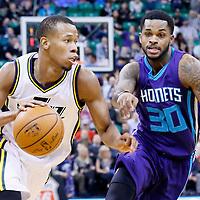 27 January 2016: Utah Jazz guard Rodney Hood (5) drives past Charlotte Hornets guard Troy Daniels (30) during the Utah Jazz 102-73 victory over the Charlotte Hornets, at the Vivint Smart Home Arena, Salt Lake City, Utah, USA.