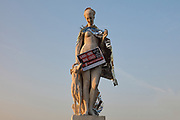 Statue of Diana the huntress, 1869, by Louis Auguste Leveque, 1814-75, decorated with an emergency foil blanket and a sign protesting the treatment of homeless people, in the Jardin des Tuileries or Tuileries Garden, in the 1st arrondissement of Paris, France. Picture by Manuel Cohen
