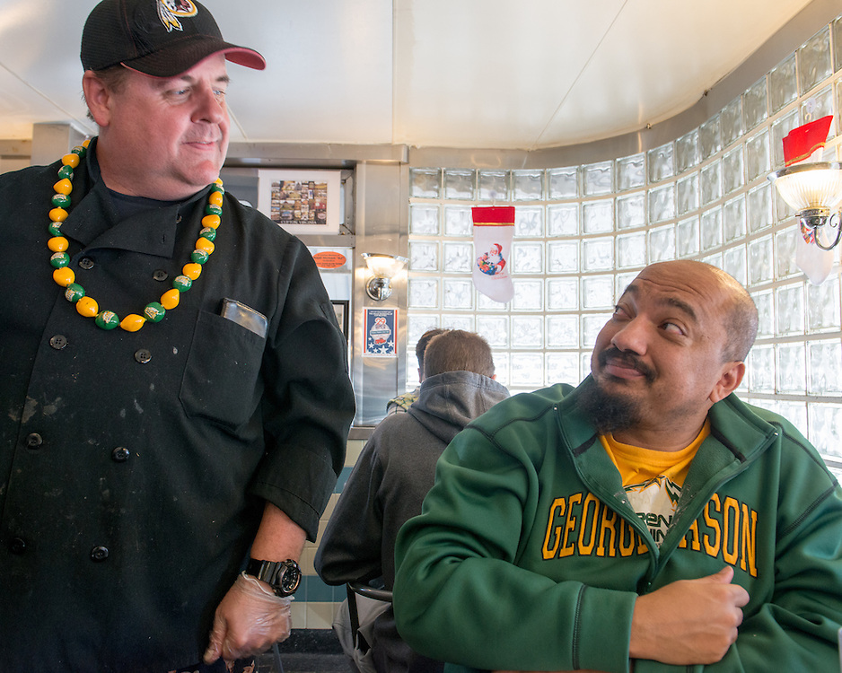 December 5, 2015 - Fairfax, VA - A day in the life of &quot;Doc Nix,&quot; aka Dr. Michael Nickens, the Director of the Athletic Bands for George Mason University. At the Rte 29 Diner with owner John Wood who is a booster of the George Mason athletic bands.<br /> <br /> Photo by Susana Raab