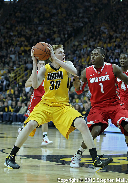 January 07, 2011: Iowa Hawkeyes forward Aaron White (30) drives on Ohio State Buckeyes forward Deshaun Thomas (1) during the the NCAA basketball game between the Ohio State Buckeyes and the Iowa Hawkeyes at Carver-Hawkeye Arena in Iowa City, Iowa on Saturday, January 7, 2012.