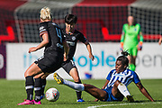 Ini Umotong (Brighton) with Millie Bright (Chelsea) & Ji So-Yun (Chelsea) during the FA Women's Super League match between Brighton and Hove Albion Women and Chelsea at The People's Pension Stadium, Crawley, England on 15 September 2019.