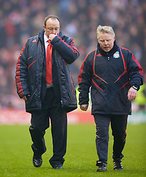 STOKE, ENGLAND - Saturday, January 16, 2010: Liverpool's manager Rafael Benitez and assistant manager Sammy Lee walk off dejected after only managing a draw with lowly Stoke City] during the Premiership match at the Britannia Stadium. (Photo by David Rawcliffe/Propaganda)