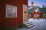 Light snow covers the courtyard of an old house, in Grythyttan, Varmland, Sweden