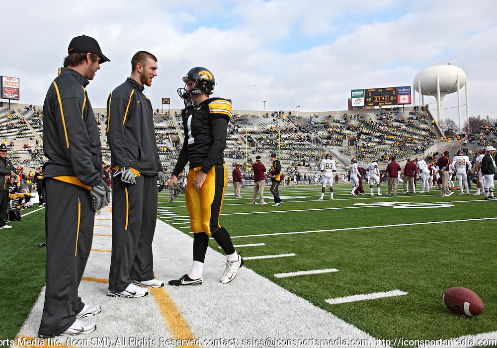 November 21, 2009: Iowa quarterback Ricky Stanzi (12) and Iowa kicker Daniel Murray (1) talk before the Iowa Hawkeyes 12-0 win over the Minnesota Golden Gophers at Kinnick Stadium in Iowa City, Iowa on November 21, 2009.