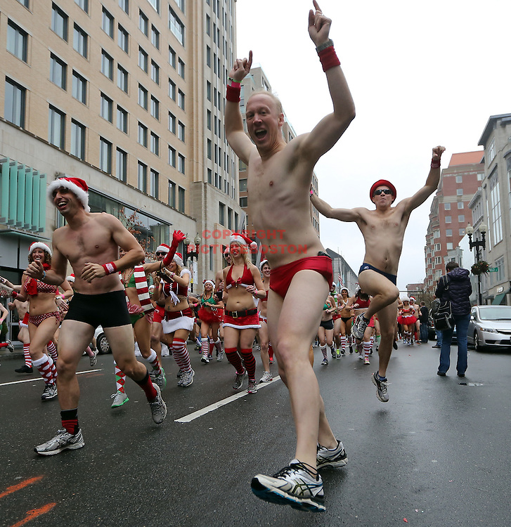 Boston,MA-12/8/2012-Participants in Boston's 12th annual Santa Speedo Run are seen in Boston's Back Bay section today. Staff photo by Mark Garfinkel