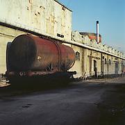Derelict industrial site with Victorian gasometer. Birkenhead, Merseyside. 2003