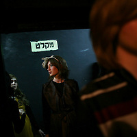 Secular models wait behind the scenes before they go on the catwalk during a fashion show for ultra orthodox women.