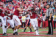 FAYETTEVILLE, AR - OCTOBER 31:  Alex Collins #3 of the Arkansas Razorbacks celebrates with teammates after scoring a touchdown against the UT Martin Skyhawks at Razorback Stadium on October 31, 2015 in Fayetteville, Arkansas.  The Razorbacks defeated the Skyhawks 63-28.  (Photo by Wesley Hitt/Getty Images) *** Local Caption *** Alex Collins