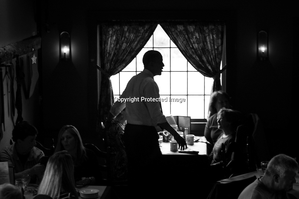 U.S. President Barack Obama greets potential voters at the Common Man restaurant in Merrimack, New Hampshire, October 27, 2012.