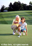 Active Aging, Senior Citizens, Retired, Activities, Grandfather Teaches Golf to Granddaughter, Active Mind, Staying Young